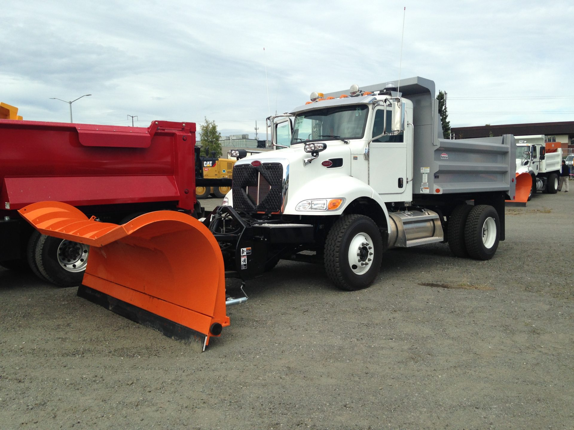Truck with a snow plow attachment on the front.