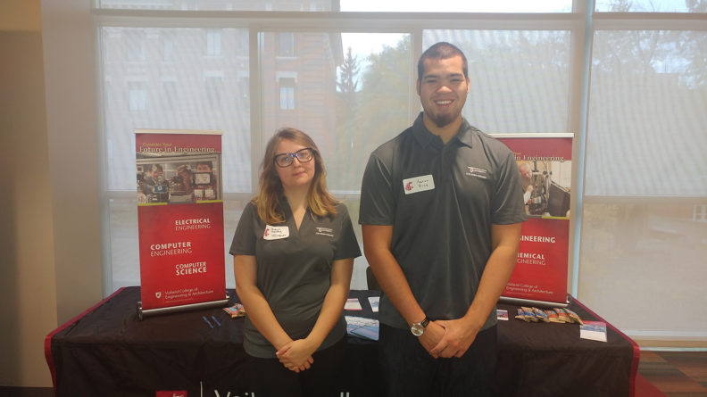 Voiland College Student Ambassadors in front of display table