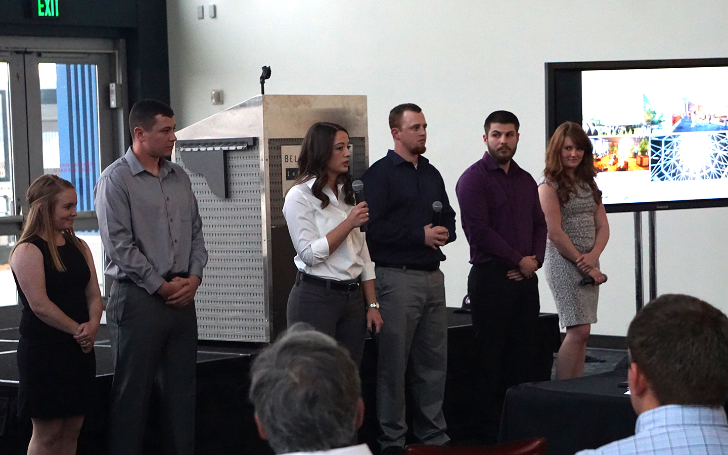 Senior architecture and construction management teams present their projects to the course sponsors.