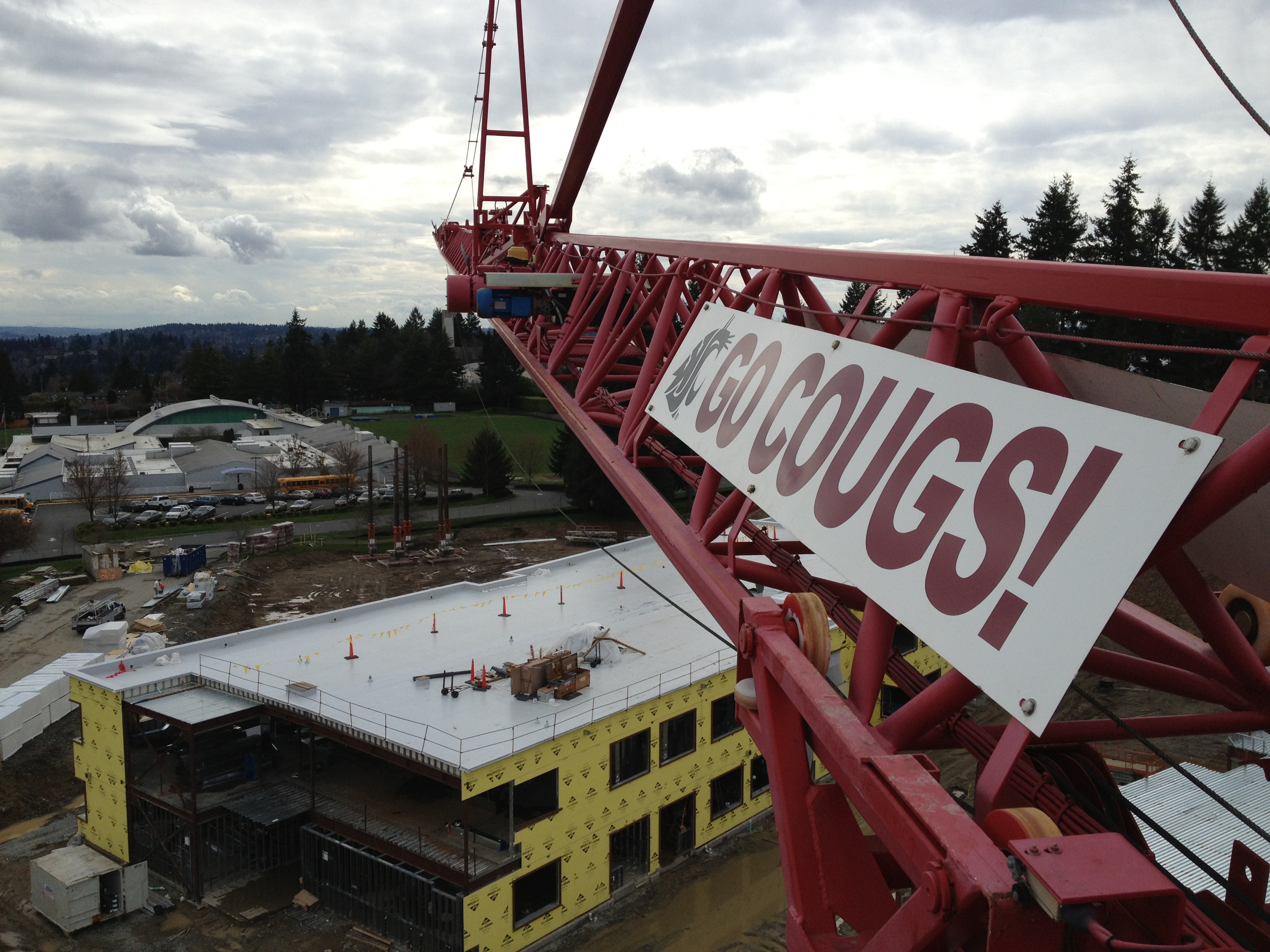 'Go Cougs!' sign on a construction crane.
