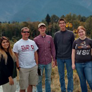 Students in front of White Horse Mountain. From left to right: Chucky Vallejo, architecture; Tyler Reid, Collin Schweikl, Philip VanDevanter, landscape architecture; Taylor Lynch, architecture.