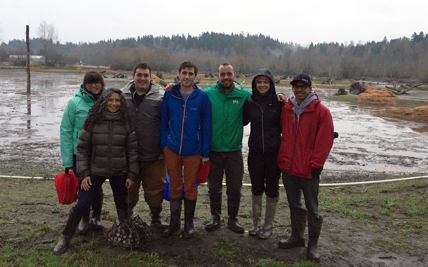 Senior landscape architecture students visit the Upper Clear Creek mitigation site with WSU landscape architecture alumnus Derrick Eberle (third from right).