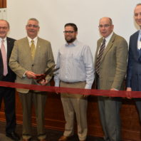 Ribbon cutting for Kiewit Construction Management Classroom, from left to right: Don Bender, interim dean of Voiland College; Scott Cassels, executive vice president of Kiewit Corporation; Jason Peschel, program head, construction management; Max Kirk, associate professor, construction management; and Phil Gruen, director, SDC