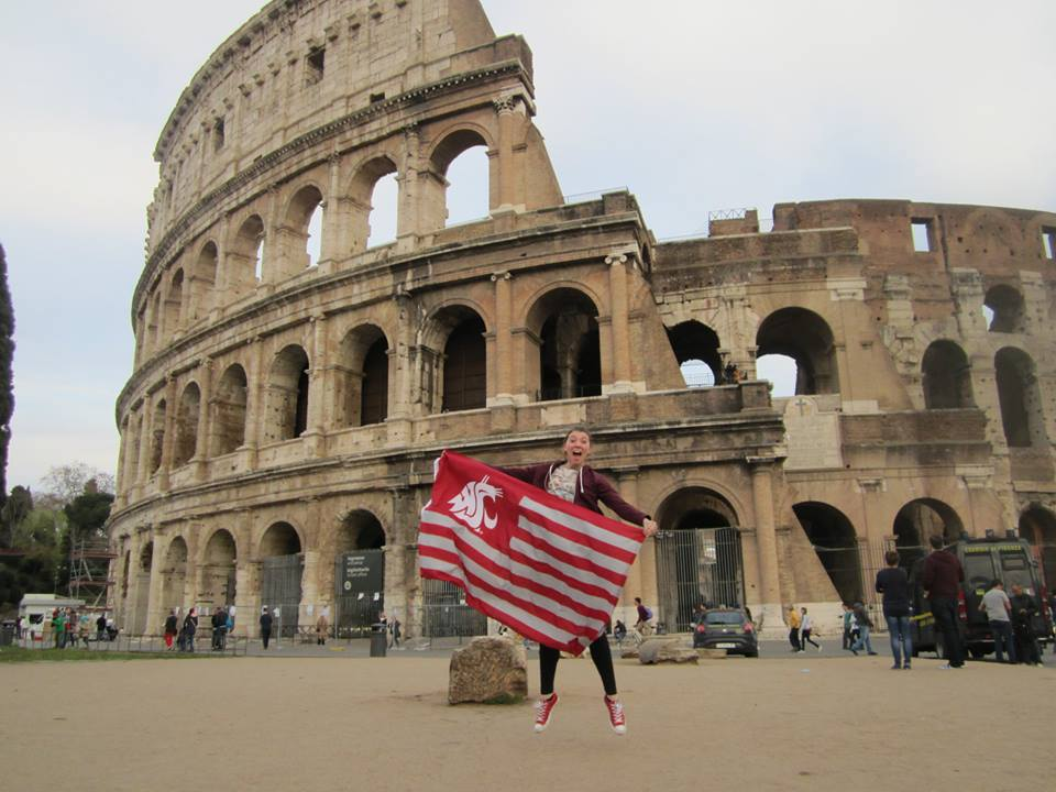Newberry waves the flag during a semester abroad in Europe.