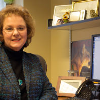 Sandi Brabb sitting at her desk.