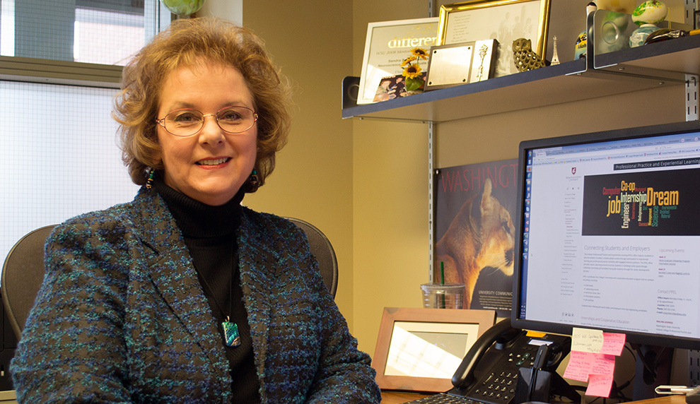 Sandi Brabb, director of Voiland College's Professional Practice and Experiential Learning program, sitting at her desk.