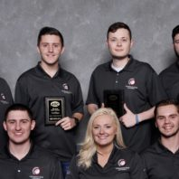 Peschel stands with students on the Commercial team. The students took 3rd place at the 2017 ASC student competition in Sparks, NV.