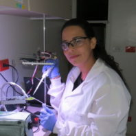 Sandra Rincon, graduate student and Fulbright scholar, using new cultivation technique for growing algae.