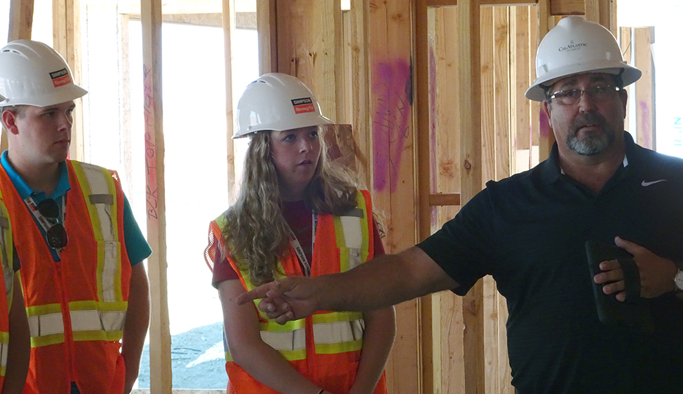 Abigail Shane and another student tour a construction site.