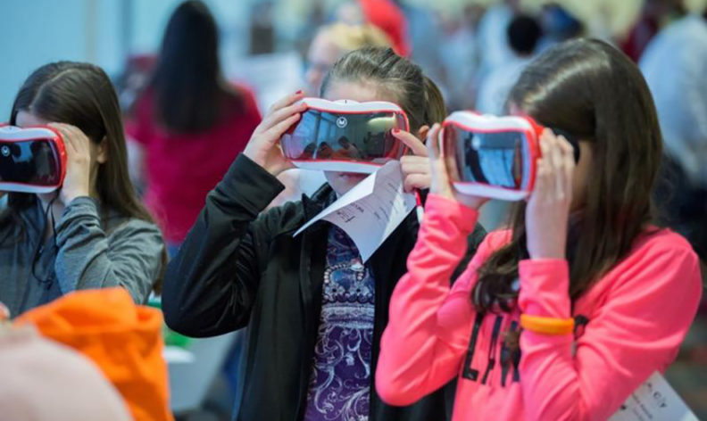 Future City students holding virtual reality technology.