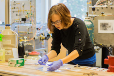 Amelia Brown tests polymer in a small research vessel.