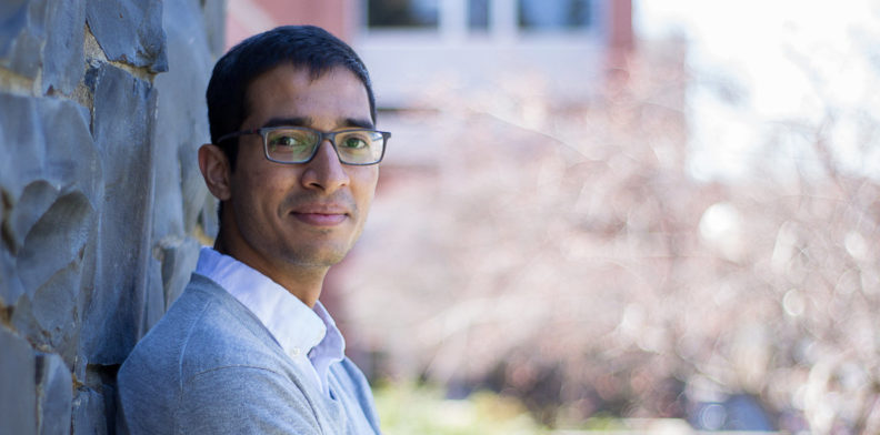 Parth Chandak leaning against a wall on the WSU campus.