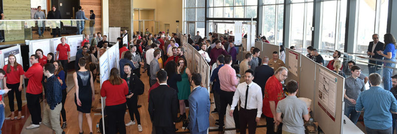 Student presenters talk with visitors at the 2018 VCEA Capstone Expo.