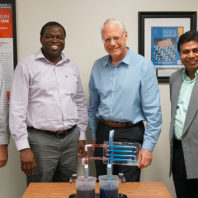 four men from WSU engineering teaching team stand side-by-side behind a scientific teaching device.