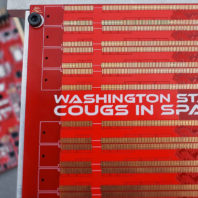 Closeup of electrical circuit board with the text Washington State Cougs in Space.