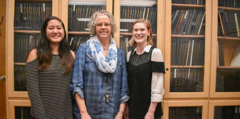 Engineering 120 professors Ashley Vu, Renee Petersen, and Katherine Harms pose in front of a bookcase.