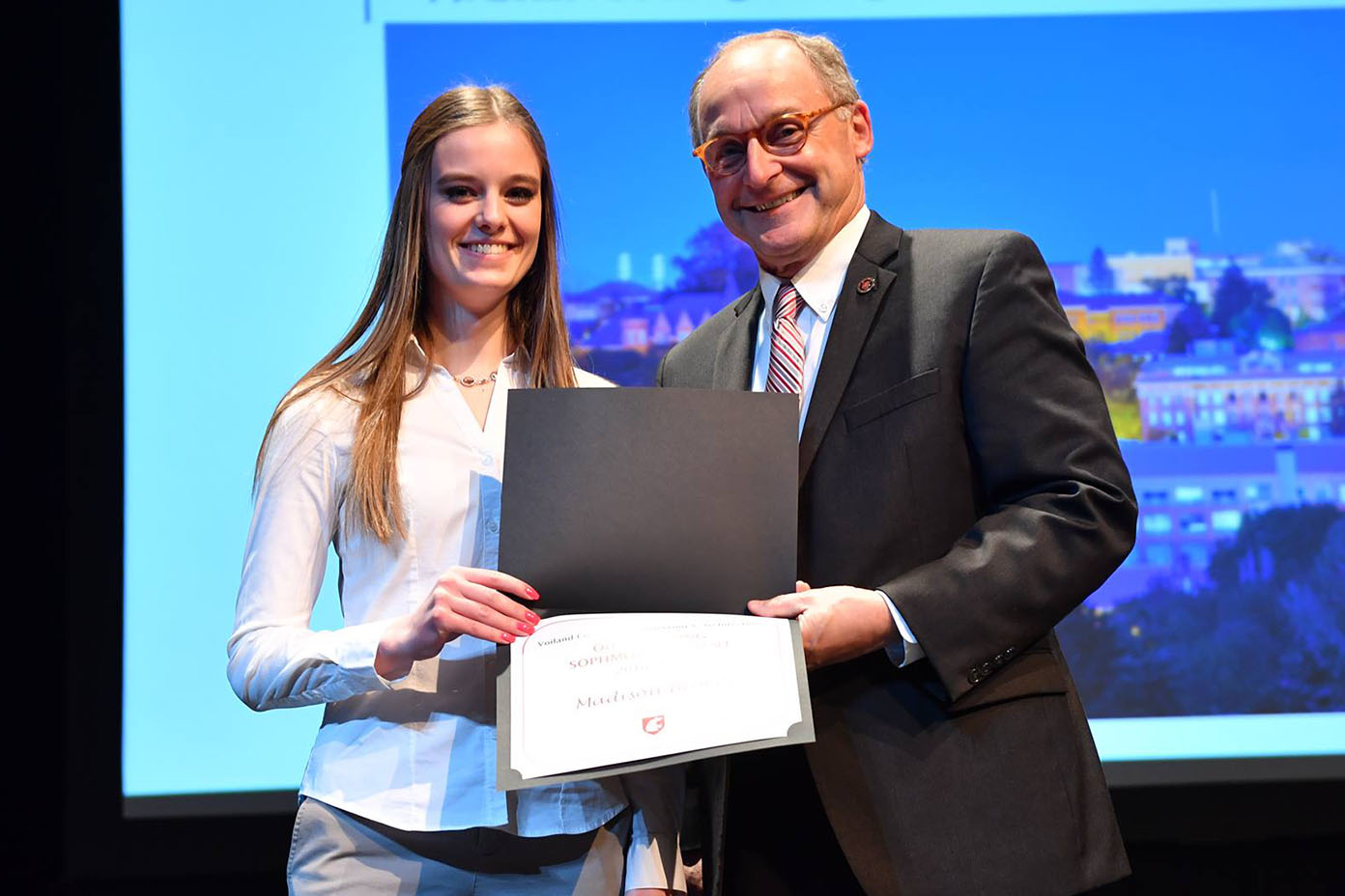 Madison Broers stands next to Don Bender holding her award.