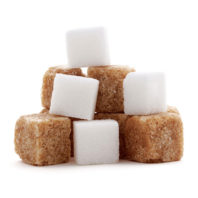 Stack of brown and white sugar cubes.