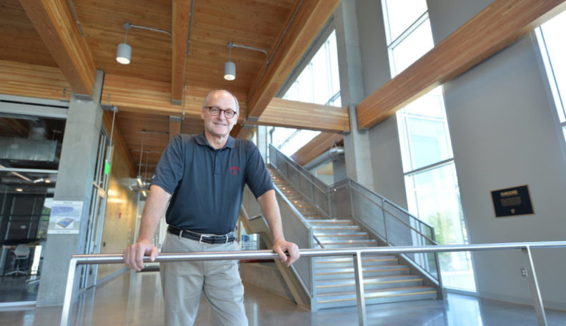 Don Bender poses in the PACCAR Clean Tech Building.