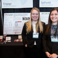 Emily and Katherine pose next to their product display at the Health Innovation Challenge.