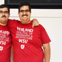 Joseph and Mario Guerrero standing side by side wearing Voiland College t-shirts.