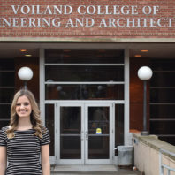 Madison Broers standing outside the Voiland College of Engineering and Architecture building.