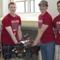 Four RoboSub Club of the Palouse students displaying their robosub.