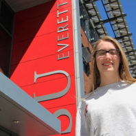 Haylie Murray standing outside a building on the WSU Everett campus.