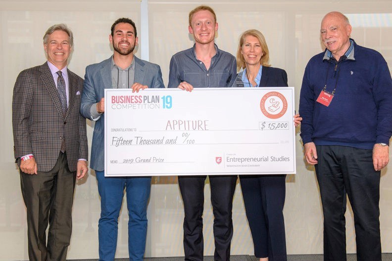 Appiture co-founders posing with an over-sized check for $15,000.