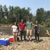 Asa Reyes-Chaves (left) poses with three members of her research team on the bank of the Naches River.