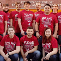 Thirteen club members wearing Voiland College t-shirts pose in front of Dana Hall in Pullman, WA.