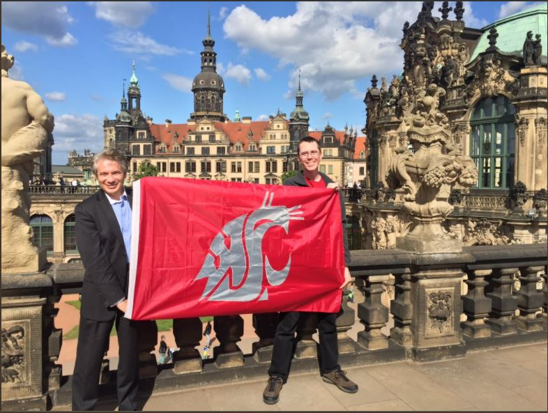 Joseph Iannelli poses holding a WSU flag along with Andrew Raub.