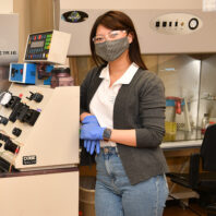 Graduate students Kitana Kaiphanliam and Brenden Fraser-Hevlin pose for a picture in the lab.