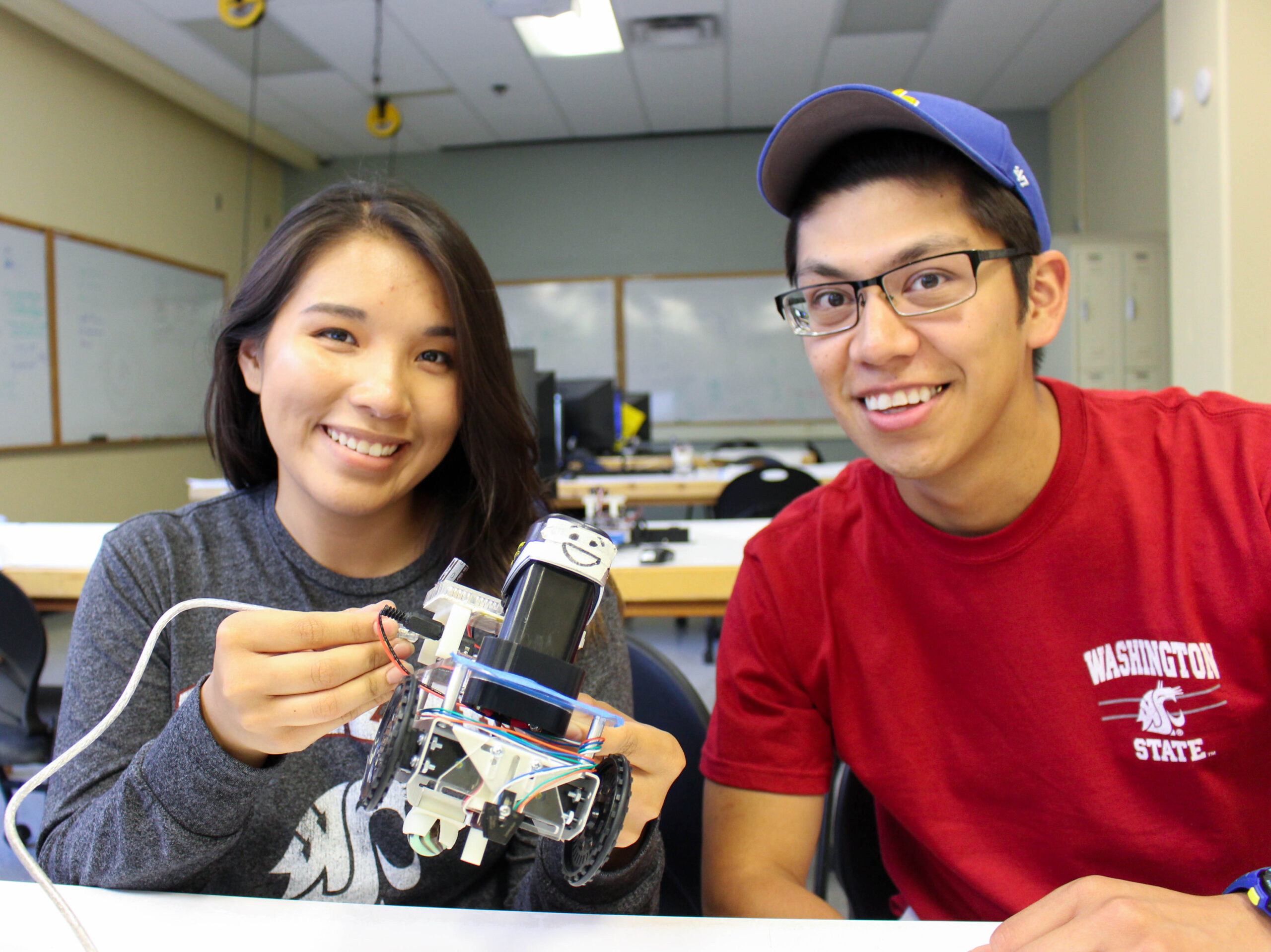Students working on a small robot in the Frank Innovation Zone.