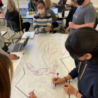 Students working together on a design concept in their lab.