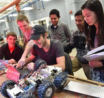 WSU students working together on a robotic vehicle.