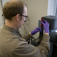 Dr. Tom Garrison in the CMEC lab loading a sample into the Q800 DMA (TA Inst.)