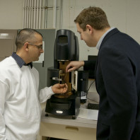 Dr. Vijay Kumar and Prof. Kessler examining a sample in the controlled stress rheometer (Discovery, TA Inst.)