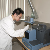 Dr. Yuzhan Li uses the thermomechanical analyzer (TMA) to measure the coefficient of thermal expansion of a composite materials.