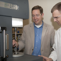Prof. Kessler and Mitch Rock load a sample into the rheometer (ARES G2, TA Instruments)