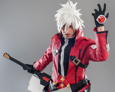 cosplayer in red and black leather, white spiky hair