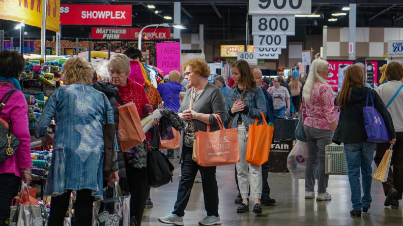 Shoppers stay busy on the show floor during the 2020 Expo.