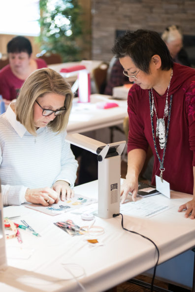 Amy Loh Kupser helps a student during class.