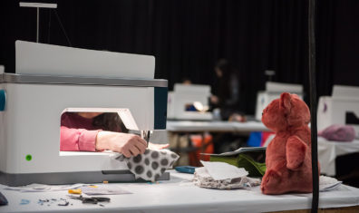 A student works on a sewing project at the 2020 Expo.