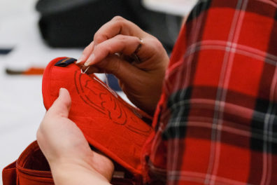A person works on hand embroidery during the 2020 Sewing & Stitchery Expo