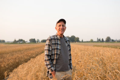 Stephen Jones stands in a wheat field