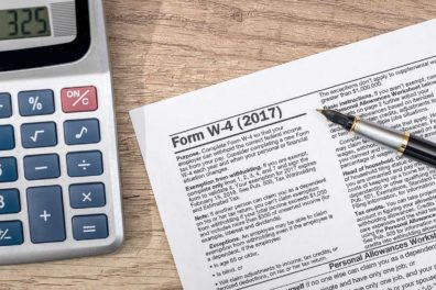 W-4 tax form with pen on desk