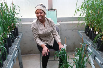 Esther Rugoli seated among plants