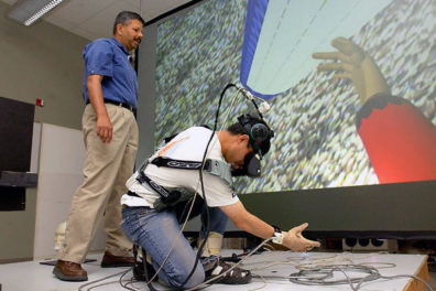 Two people setting a virtual reality device
