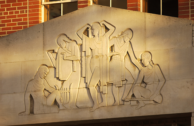 Image of female athletes stone relief sculpture